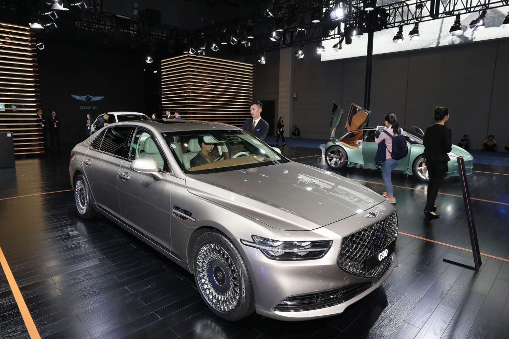 People look at a Hyundai Genesis G90 car during the 2nd China International Import Expo (CIIE) at the National Exhibition and Convention Center