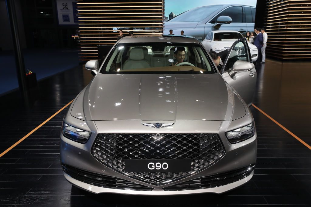 A Genesis G90 on display at an auto show