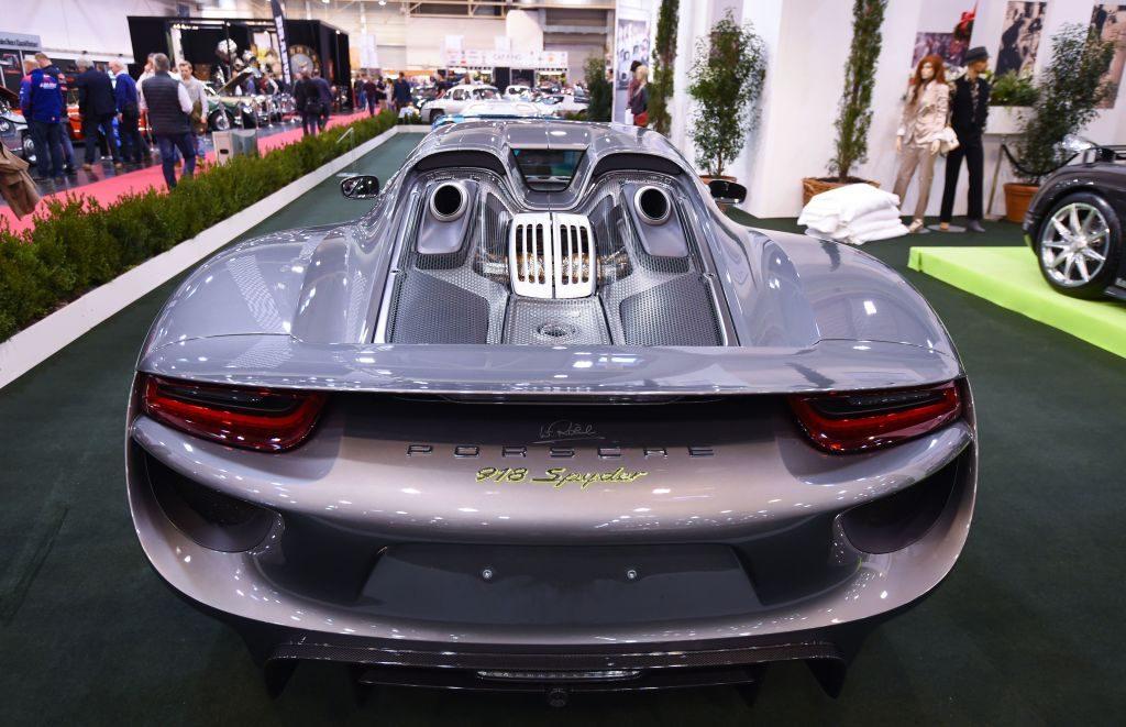 The rear of a silver 2015 Porsche 918 Spyder.