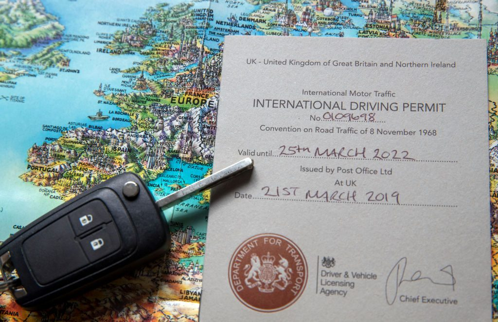 A UK International Driving Permit (IDP) placed on a map of Europe.