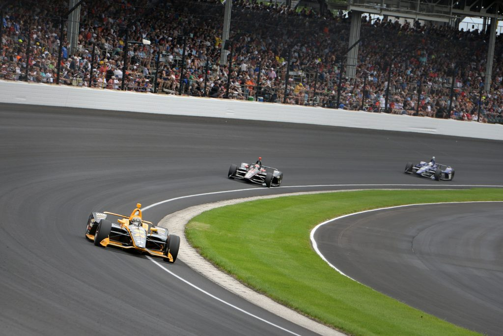 Drivers take a corner on the racetrack at the Indianapolis 500