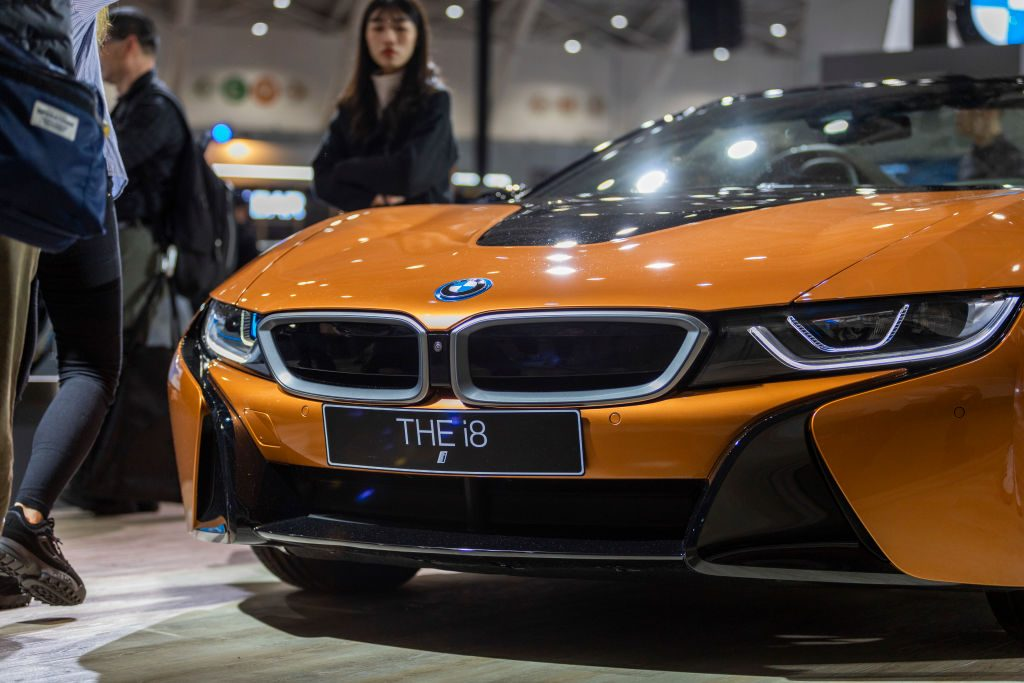 The front end of an orange 2020 BMW i8 hybrid supercar.