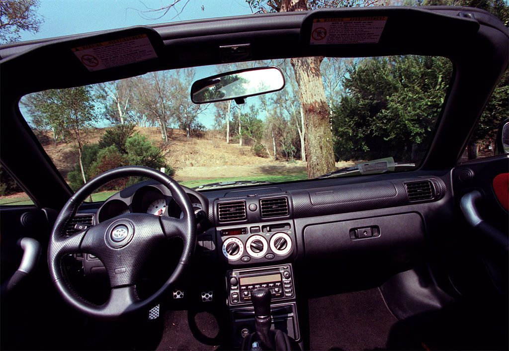A close-up of a Toyota MR2 Spyder's dashboard.