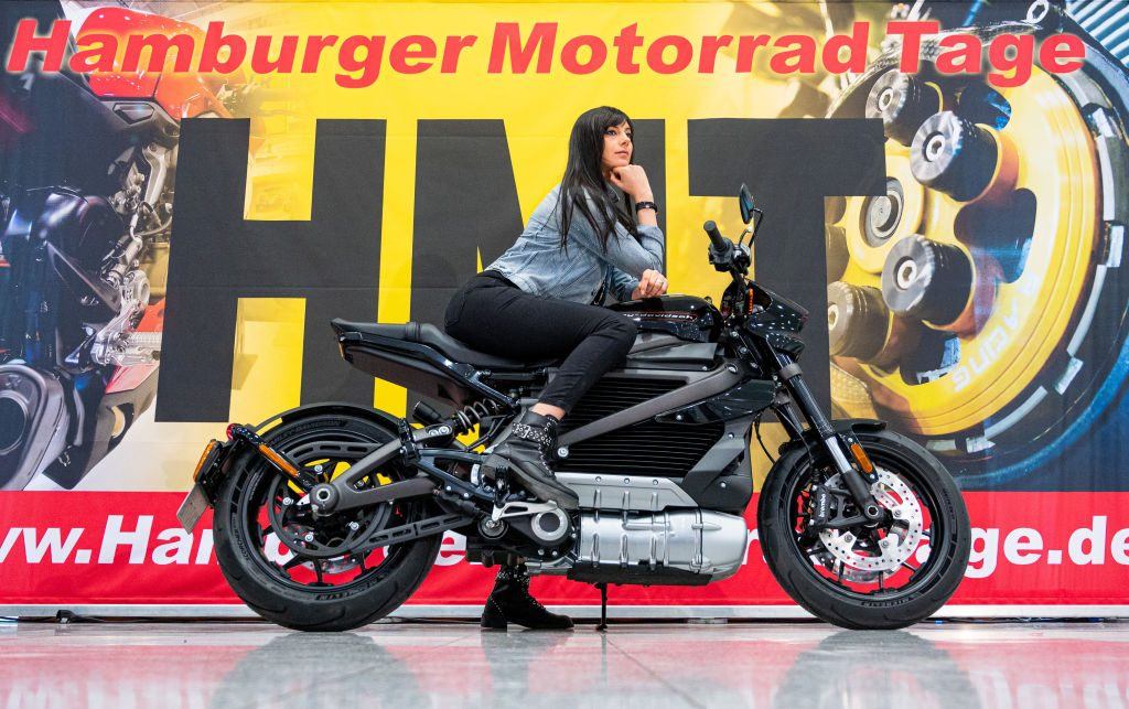 A model poses on a Harley-Davidson electric motorcycle during a press conference for the Hamburg Motorcycle Days
