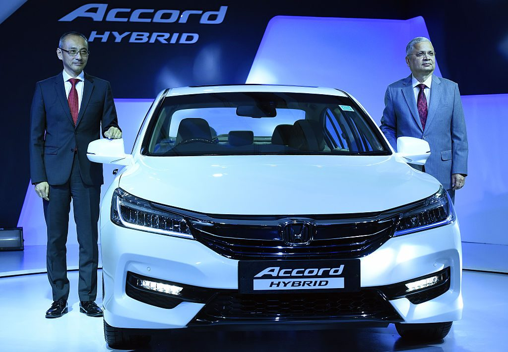 Yoichiro Ueno, President and CEO of Honda Cars India Ltd., and Raman Sharma, Director of Corp. Affairs Honda Cars India Ltd., during the launch of the all new Honda Accord Hybrid Feather Car