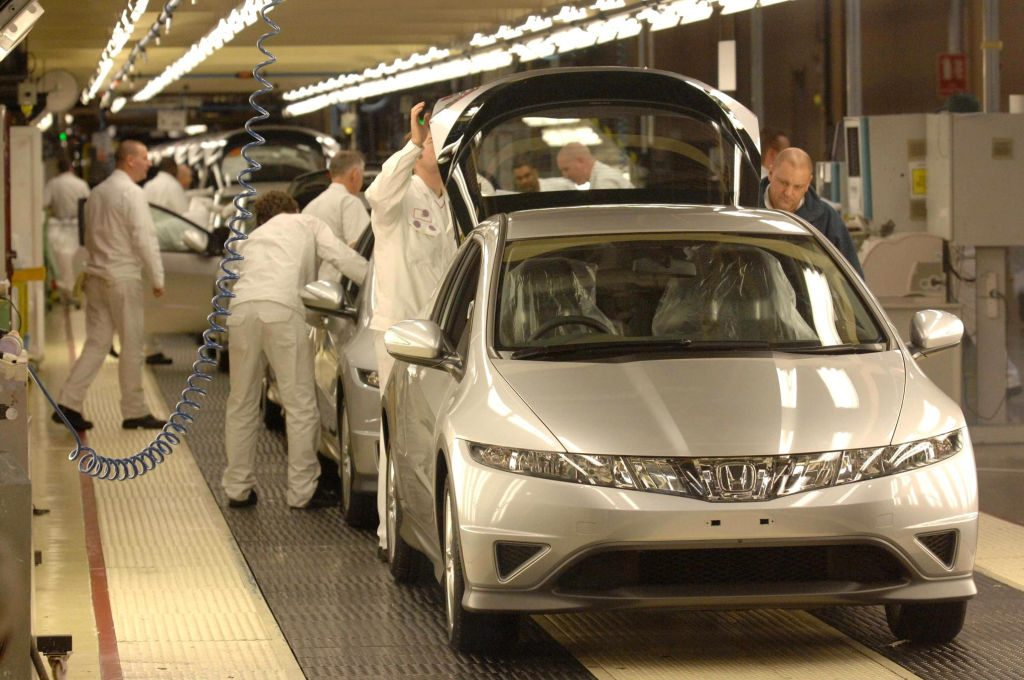 A Honda Civic being assembled at a factory