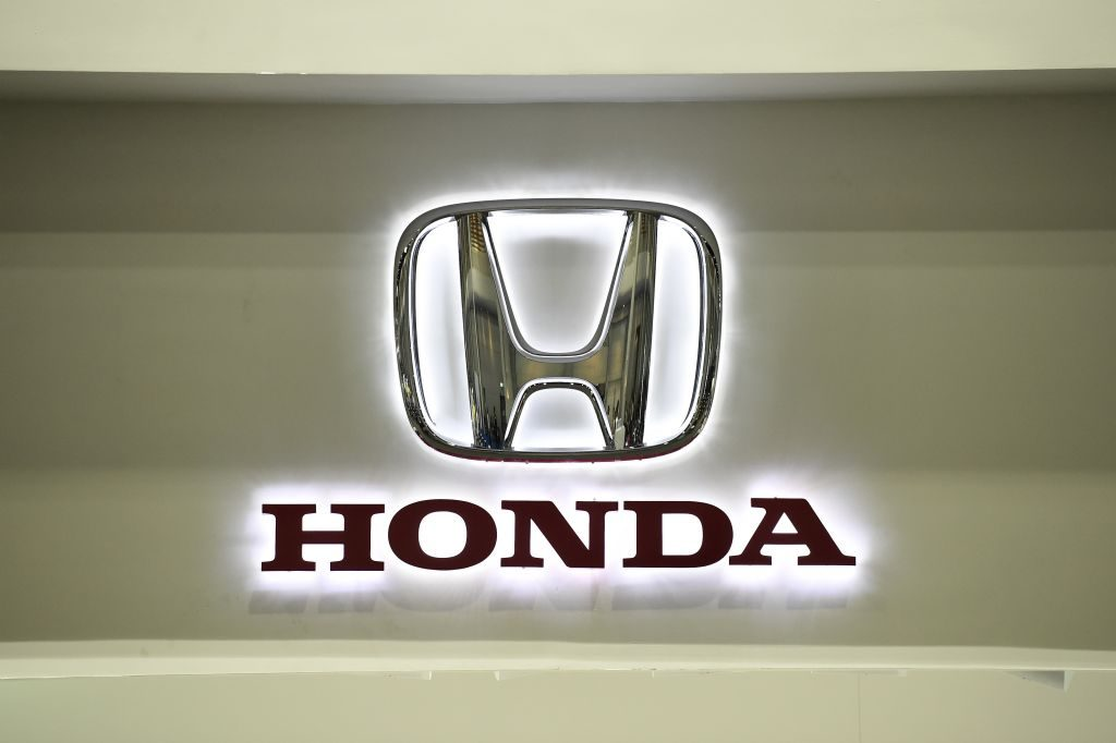 A Honda logo on a wall