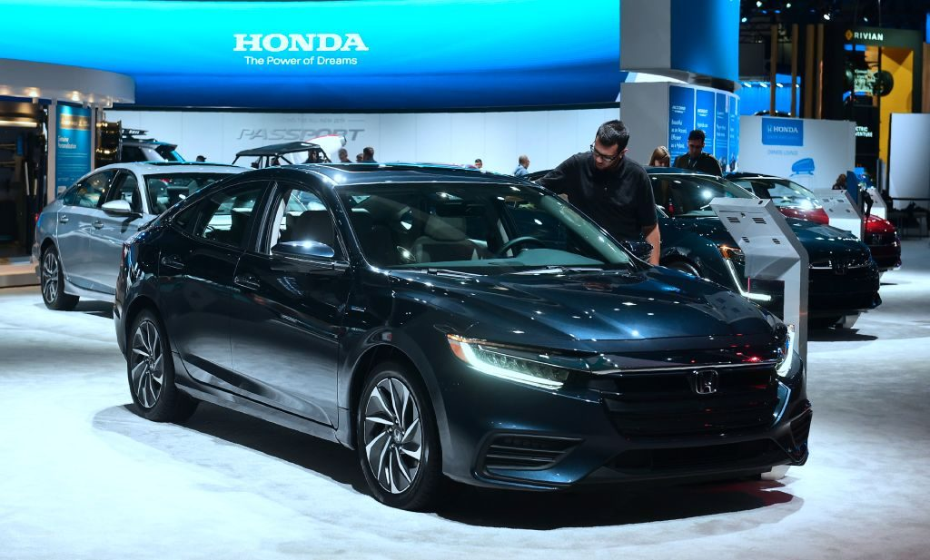 A man views the Honda Insight, named Green Car of the Year, on display in Los Angeles, California