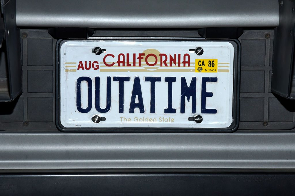 """OUTATIME"" license plate from the ""Back To The Future"" DeLorean at the Hollywood Museum's ""Back To The Future"" Trilogy: The Exhibit"