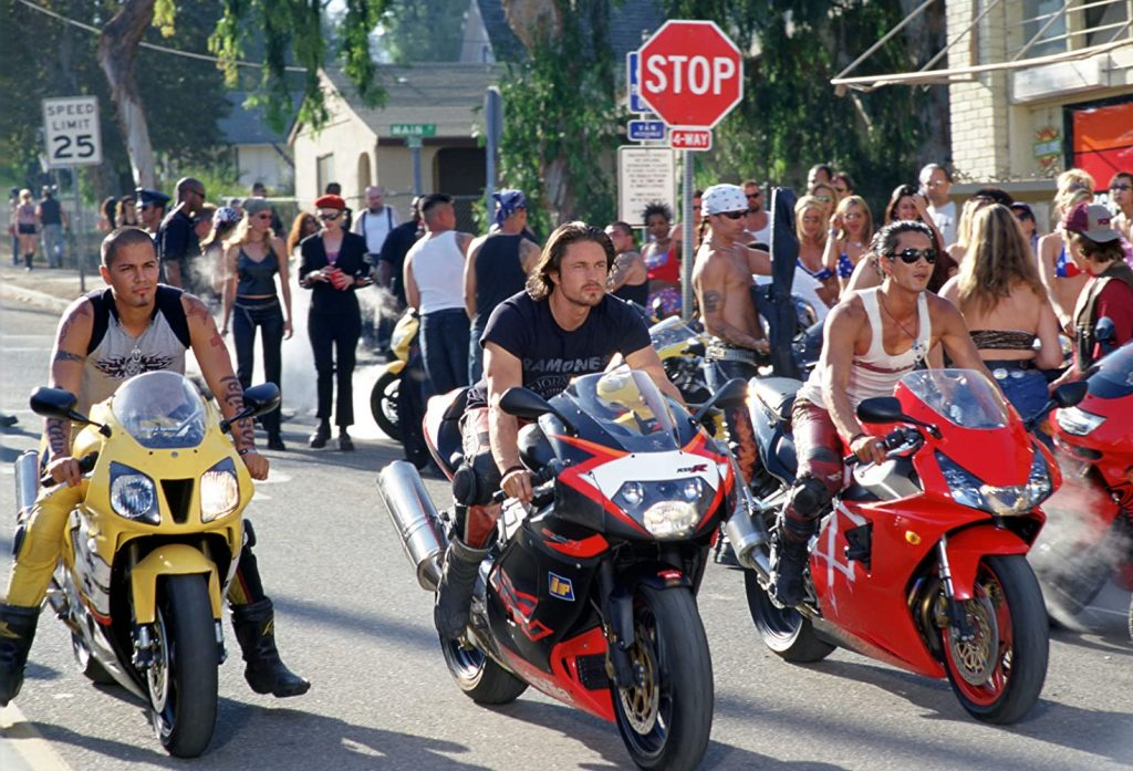 A scene from the 2004 movie Torque in which three motorcycle racers are lined up.