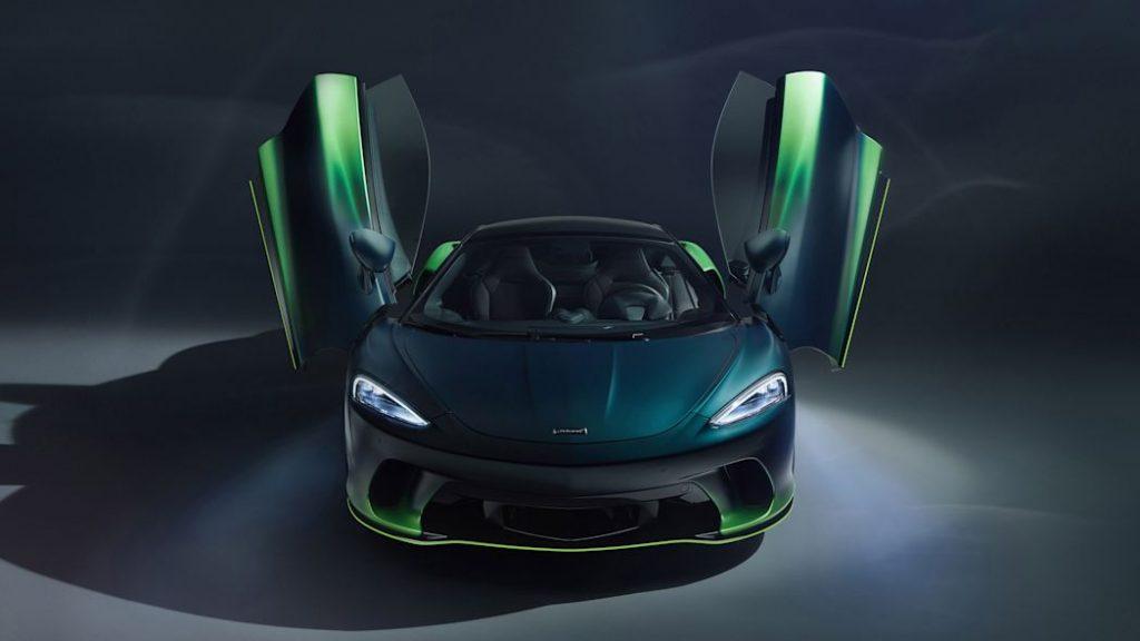 green McLAren GT Verdant with scissors doors open