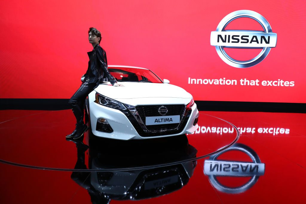 A model poses next to a NISSAN Altima at the Seoul Motor Show 2019
