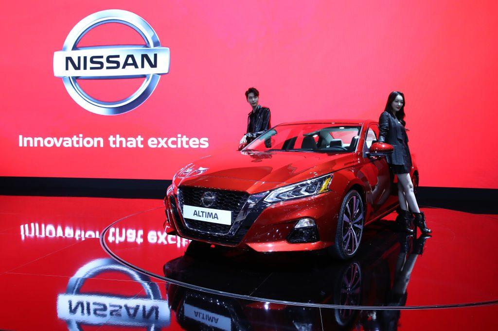 Models pose next to a NISSAN Altima at the Seoul Motor Show 2019 at KINTEX on March 28, 2019