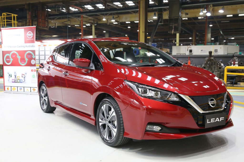 A red Nissan Leaf on display | Nissan