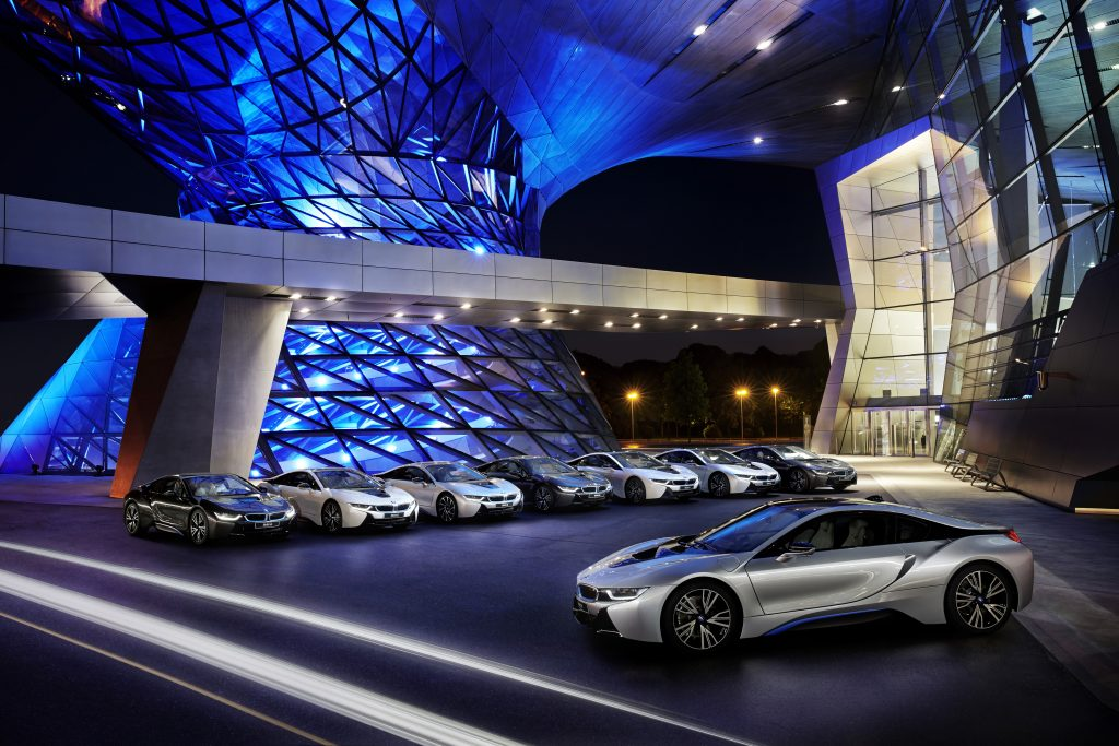 A collection of 2015 BMW i8 supercars parked outside of the BMW Welt in Munich, Germany.