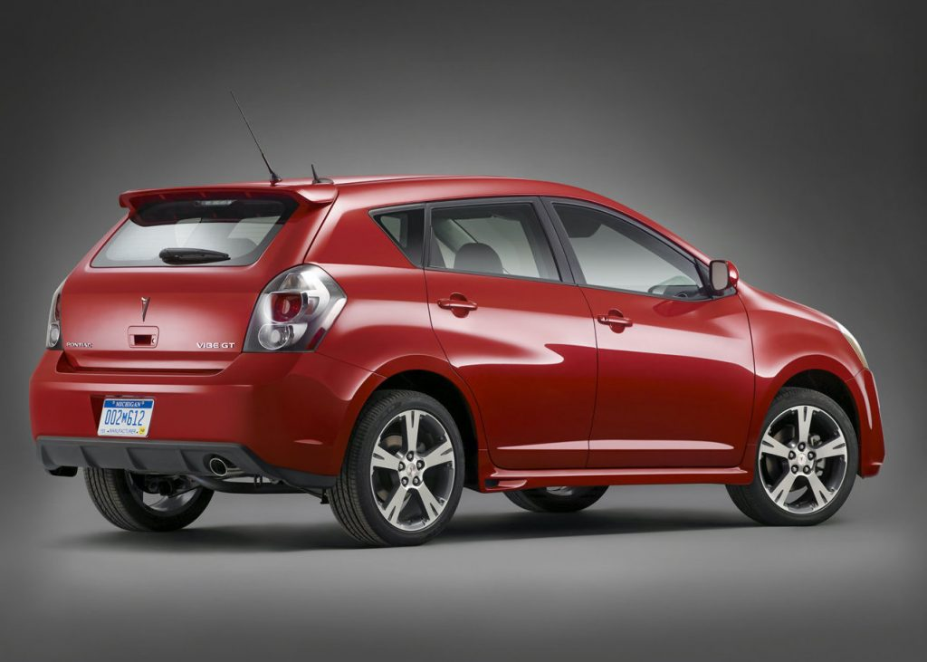 press photo of a red Pontiac vibe against a gray backdrop is one of consumer reports best used cars and SUVs under $10,000