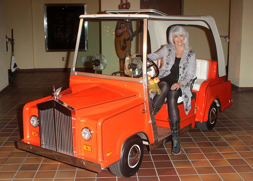 A Red Rolls Royce Golf Cart Conversion