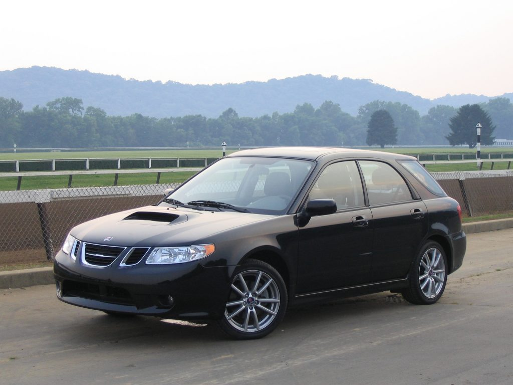 A black 2005 Saab 9-2X parked off of a scenic highway.