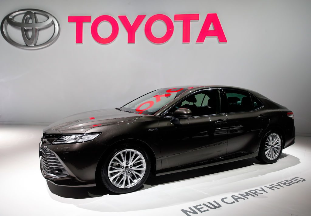 A new Toyota Camry hybrid automobile is on display during the second press day of the Paris Motor Show