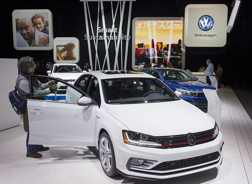 Attendees look at the the Volkswagen Jetta during the 2017 North American International Auto Show in Detroit, Michigan