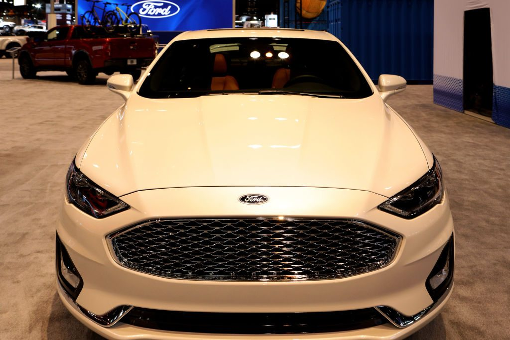 A white Ford Fusion on display