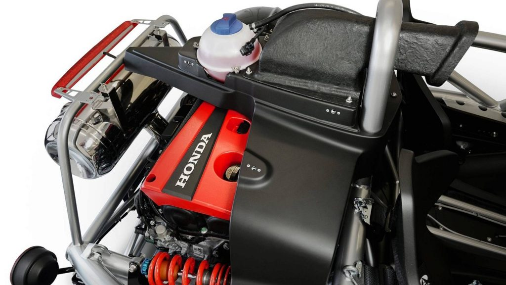 Shot of the Ariel Atom 4's Honda Civic Type R engine's red cover