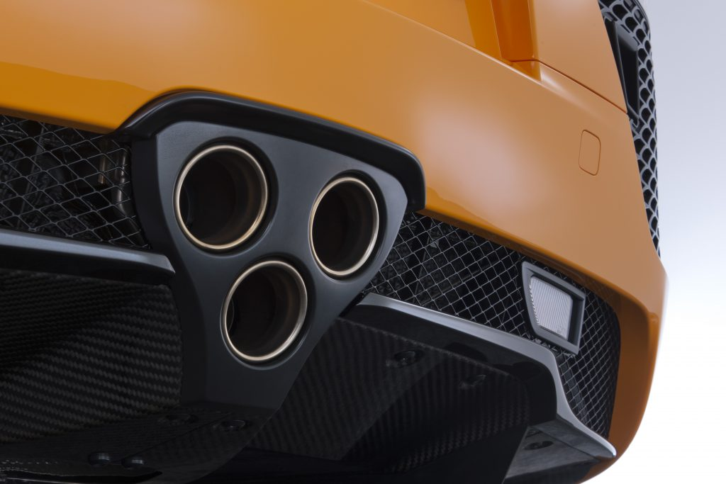 A close-up of the triple stacked triangular exhaust design of the 2012 Lexus LFA.