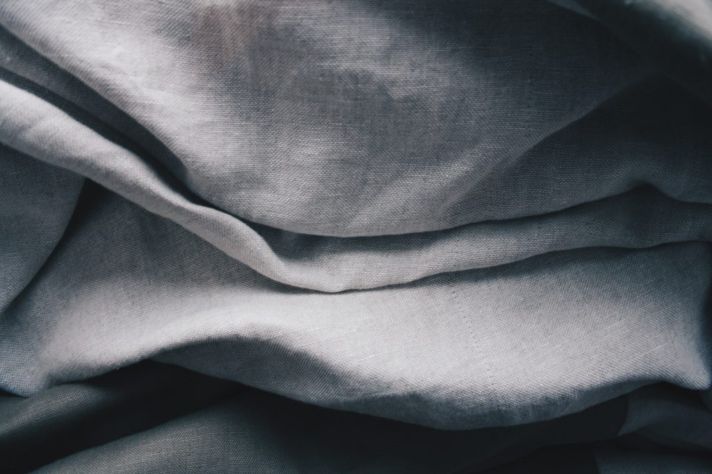 A close-up of a grey blanket for use in roadside emergency kits.