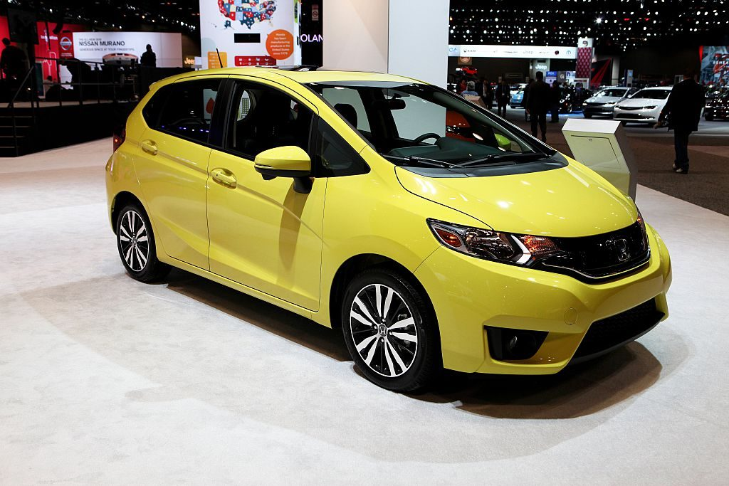A 2015 Honda Fit on display at an auto show