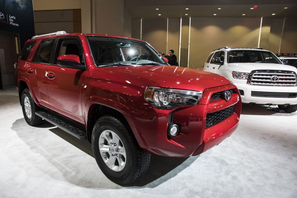 A red 2017 Toyota 4Runner on display at an auto show