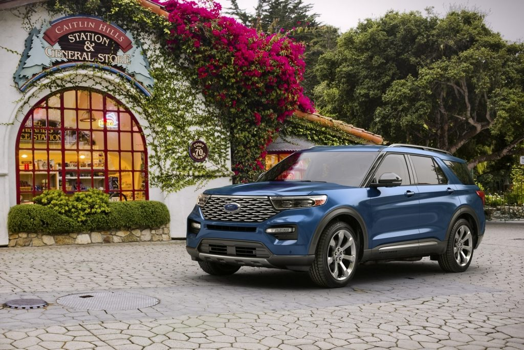 2020 Ford Explorer Platinum parked on street near homes