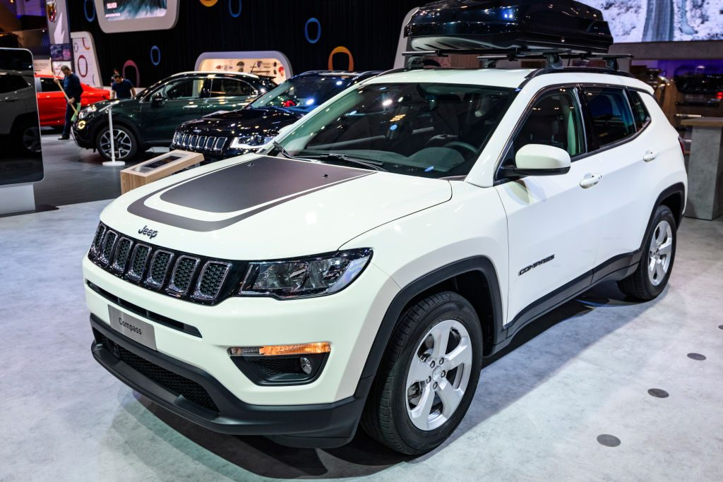 A 2020 Jeep Compass on display at an auto show