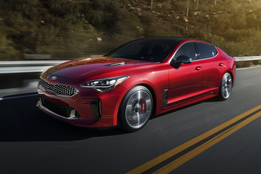 A red 2020 Kia Stinger on the track.