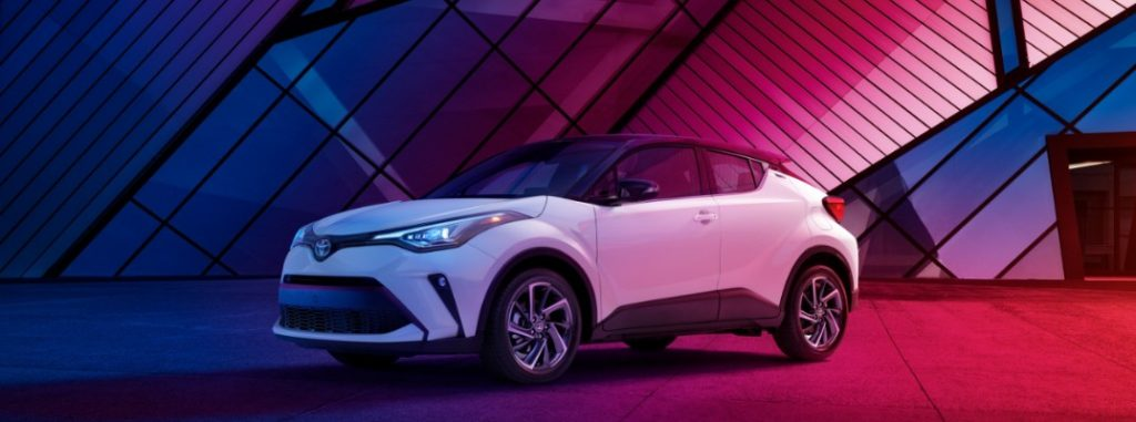 white 2020 Toyota C-HR in pink and blue lighting