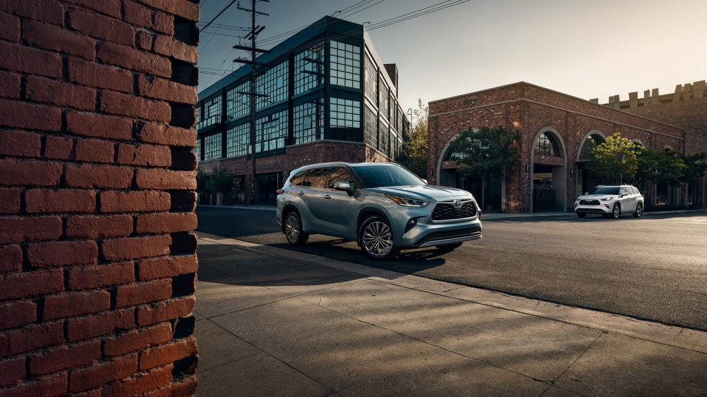 2020 Toyota Highlander SUV driving down city street