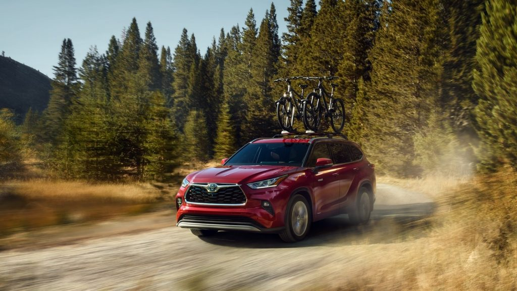 2020 Toyota Highlander Hybrid driving down dirt road