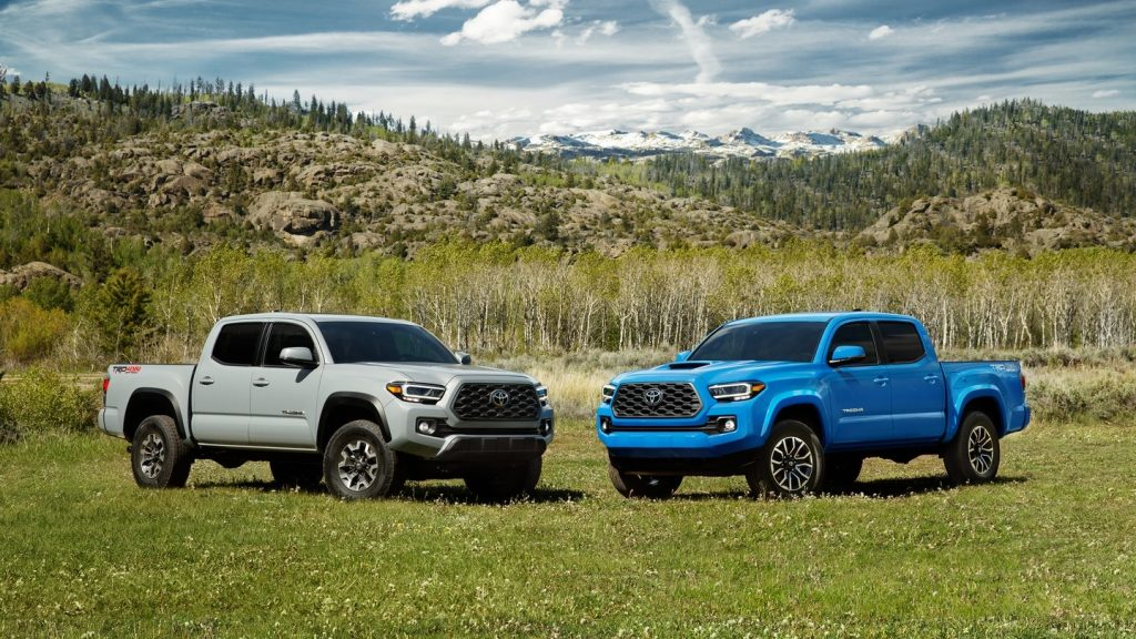 Two 2020 Toyota Tacoma TRD Off-Road trucks parked in a field