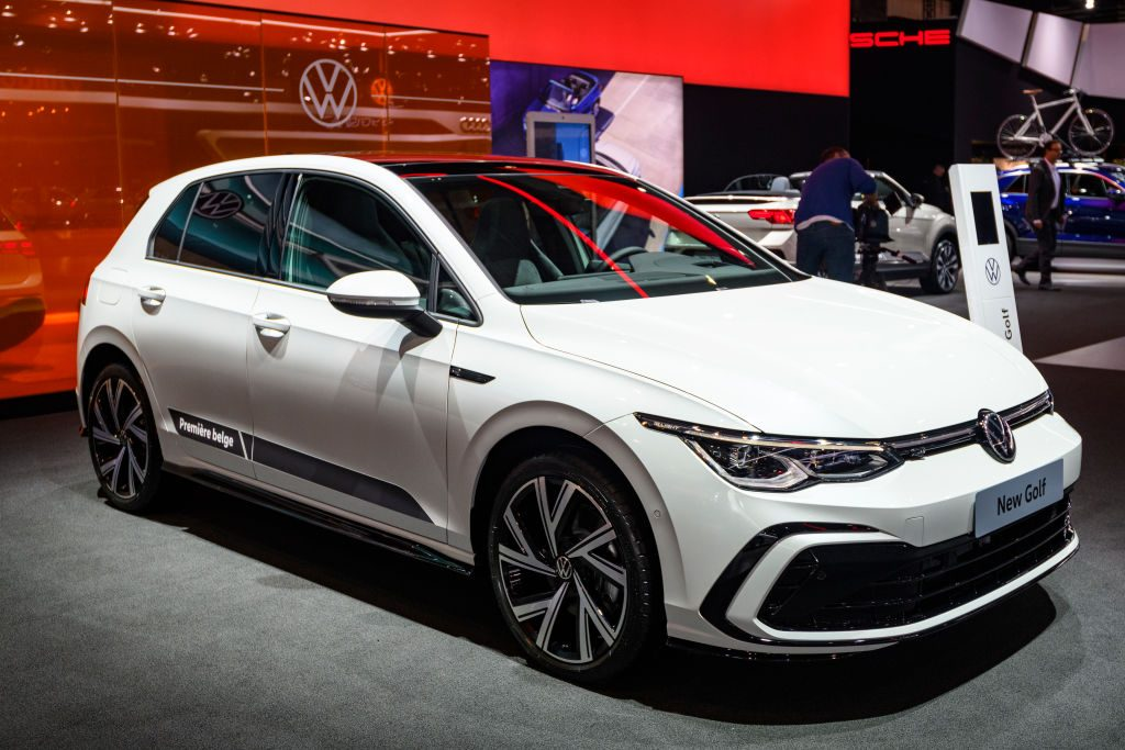 A white Volkswagen Golf on display at an auto show