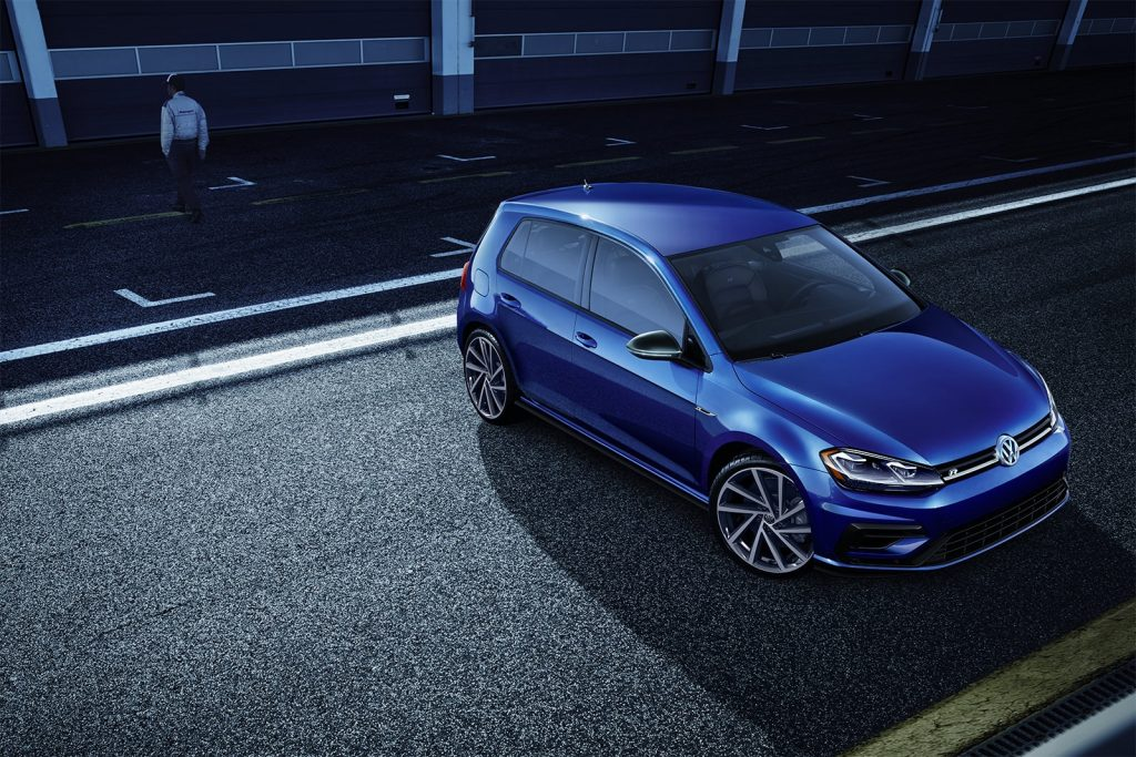 Navy blue 2020 Volkswagen Golf R on the track.
