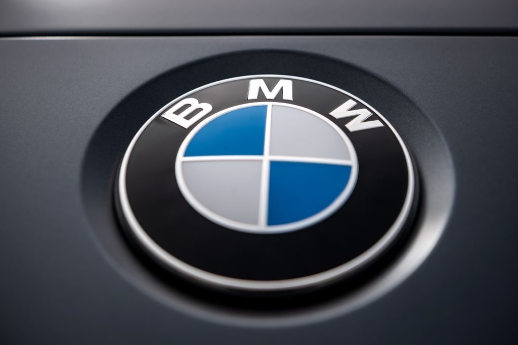 The logo of the Munich car manufacturer BMW can be seen on a car
