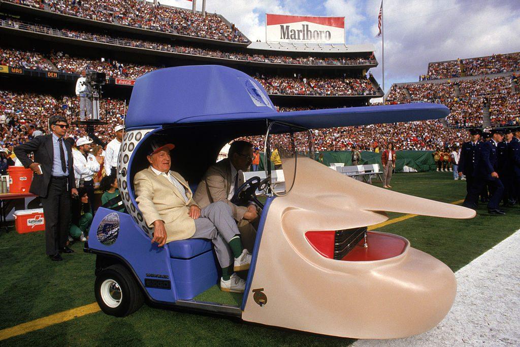 Bob Hope sitting in his George Barris designed golf cart