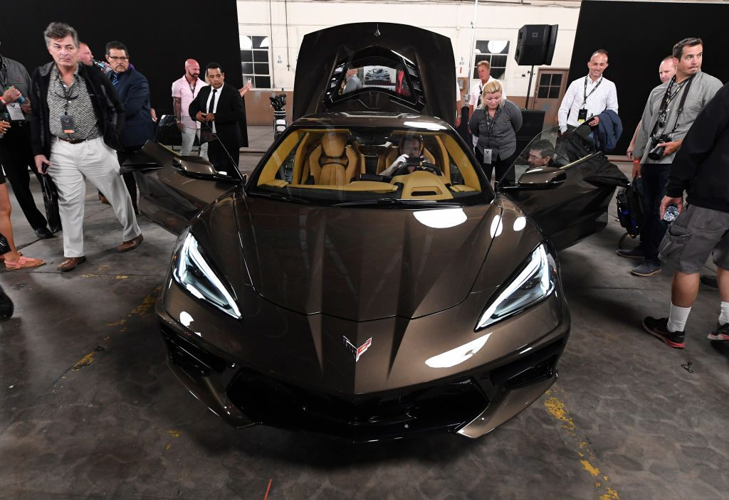 People gather around to look at the new Chevy C8 Corvette