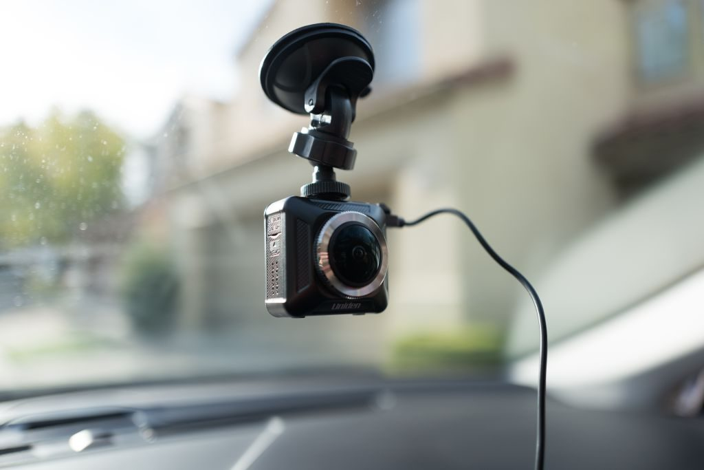 A dashcam installed on an Uber driver's windshield