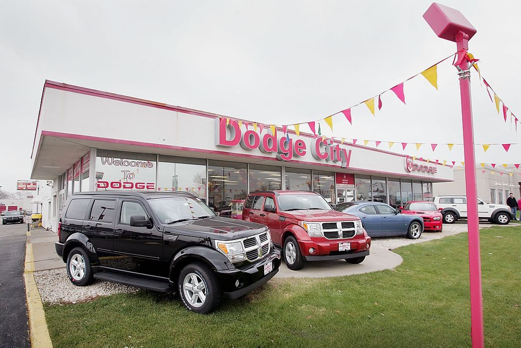 Dodge vehicles on display at a car dealership
