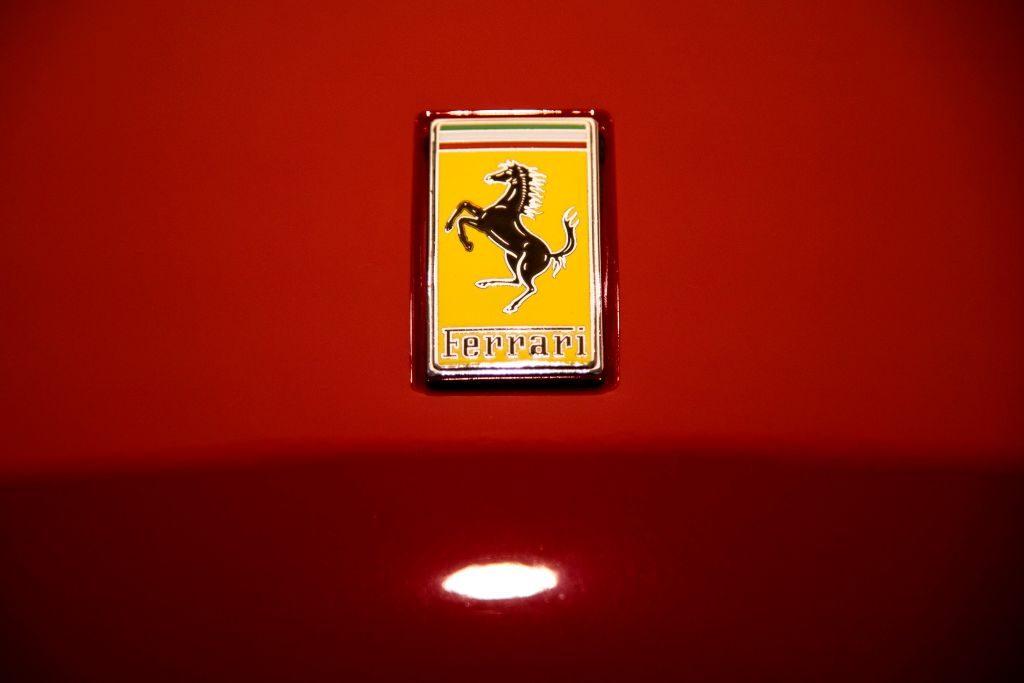 A Ferrari logo on the hood of a car