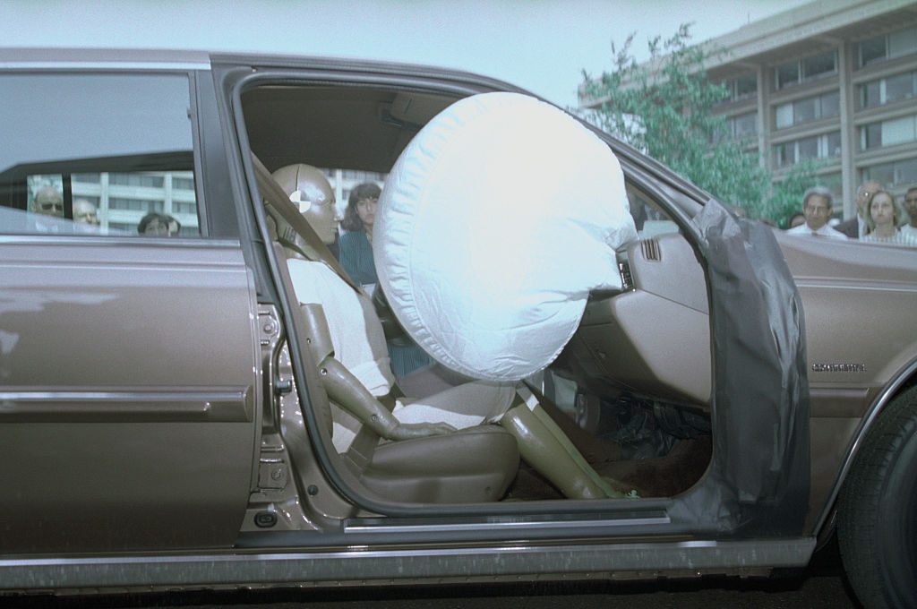 An airbag test being performed on a Ford car