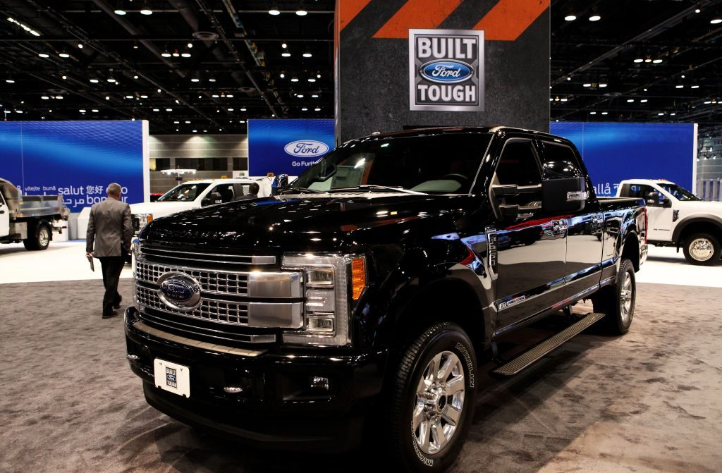 A black Ford F-250 on display at an auto show