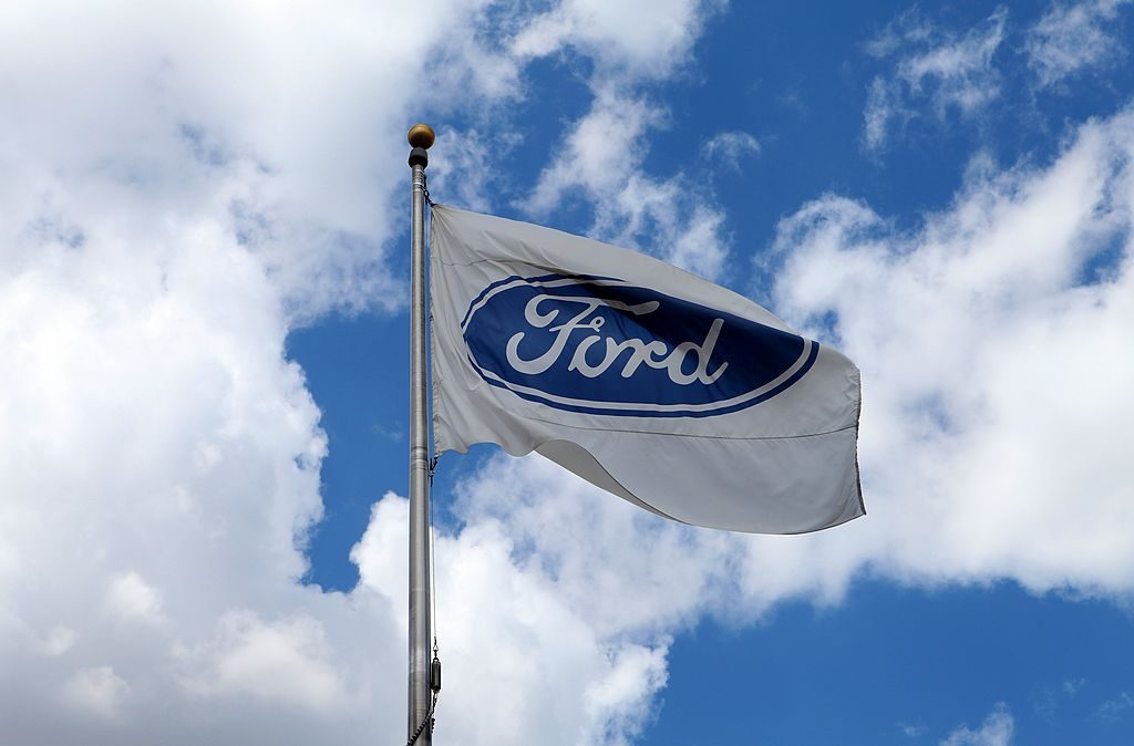 A Ford flag flies outside the Ford Motor Company Conference and Event Center