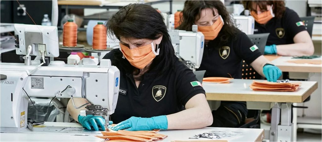 Lamborghini workers make face masks