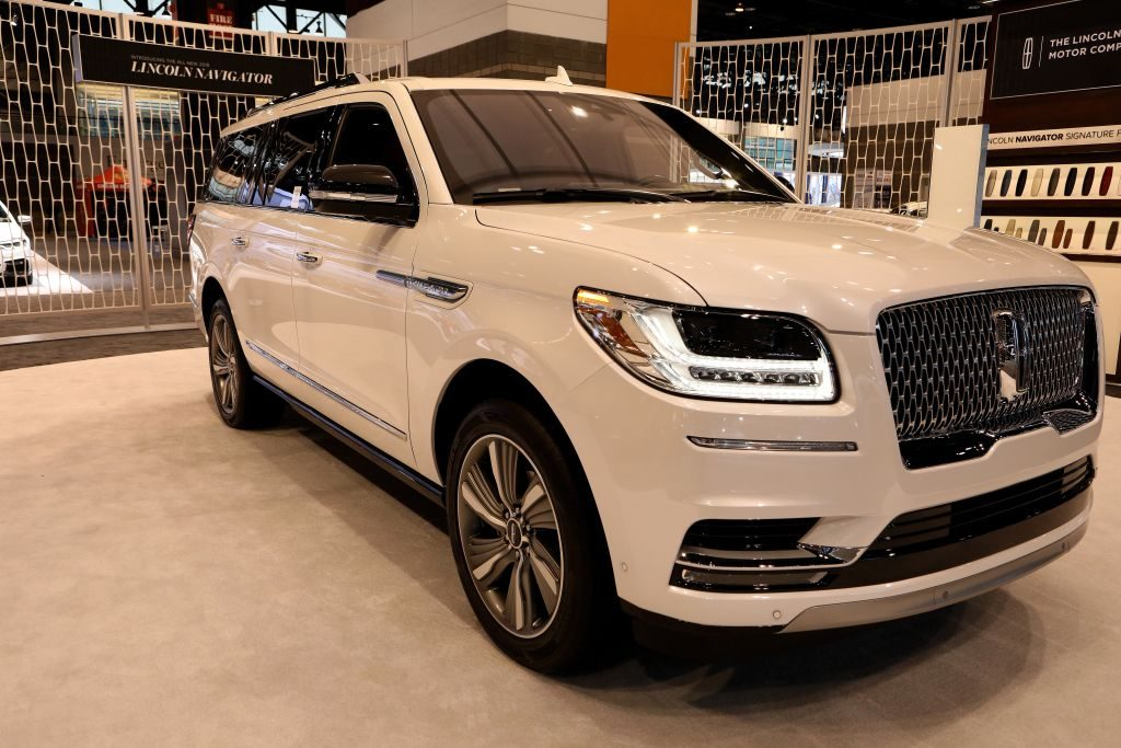 A white Lincoln Navigator on display at an auto show